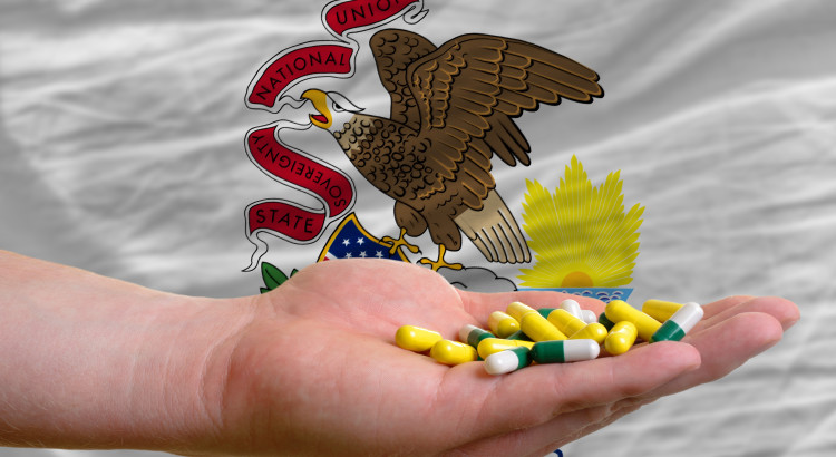 man holding capsules in front of complete wavy american state flag of illinois symbolizing health, medicine, cure, vitamines and healthy life